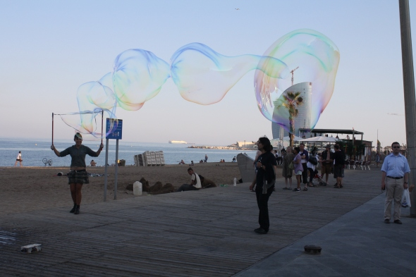 Walking on the Mediterranean coast in Barcelona, B and I came across this street performer.  Barcelona loves street performers - which I don't - but I thought the bubbles were amazing.  Credit: B took this pic.