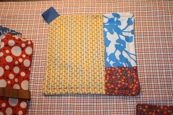 Like the napkins, this potholder and all the fabrics used in this project were re-used.